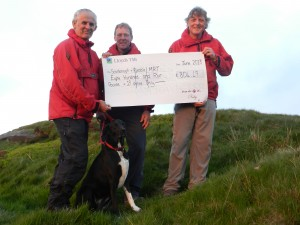 Roger Hartley, incident controller on the day, John Robinson, 'team' Vet and Mark Saunders, first on scene and find site manager on the day.  Ruby and cheque in the foreground.