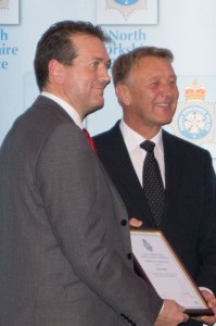 Ian Peckitt (left) receives his individual award from the Lord Lieutenant